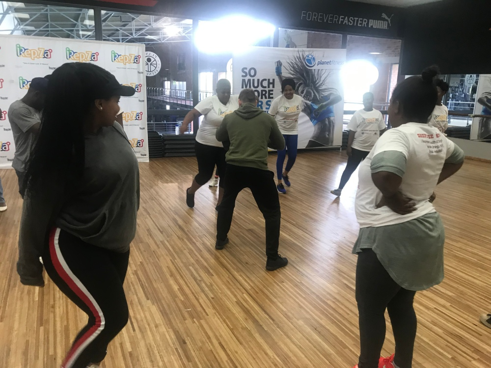 SheFense Campaign Training - Women learning how to kick.